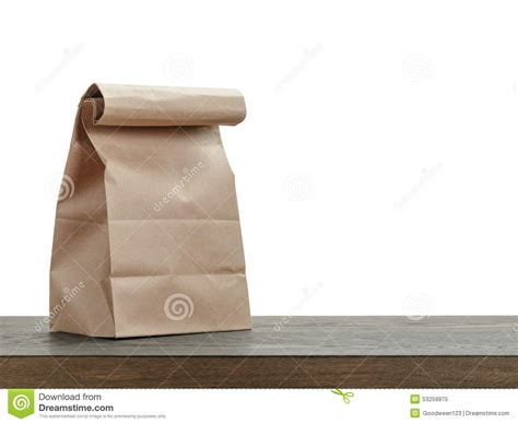 Simple Paper Bag - simple brown paper bag for lunch or food on wooden stock