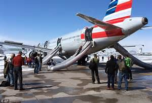 american airlines flight forced to return to gate after american airlines passengers use emergency slides as smoke