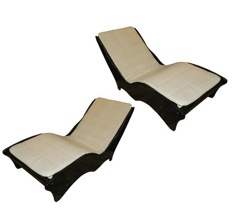 ergonomic chaise lounge pair of lacquer and leatherette ergonomic chaise lounges