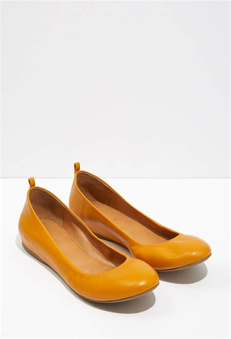 mustard colored flats forever 21 classic ballet flats in orange lyst