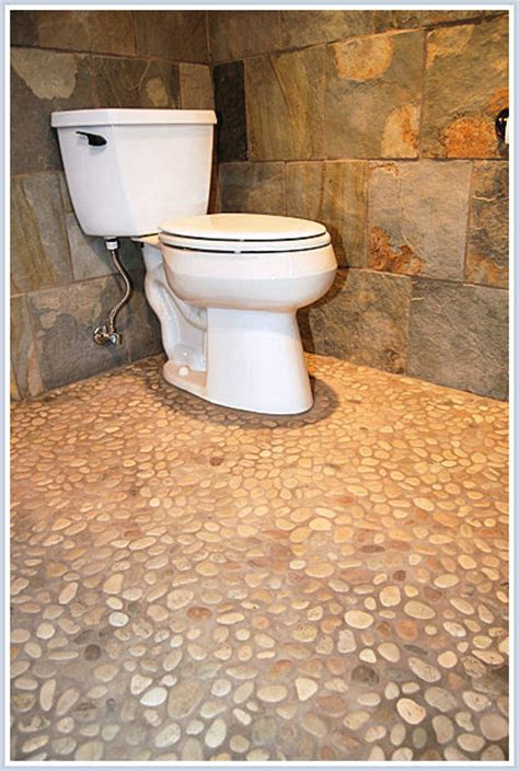 pebbles in bathroom love the river stone pebble floor what is the color of
