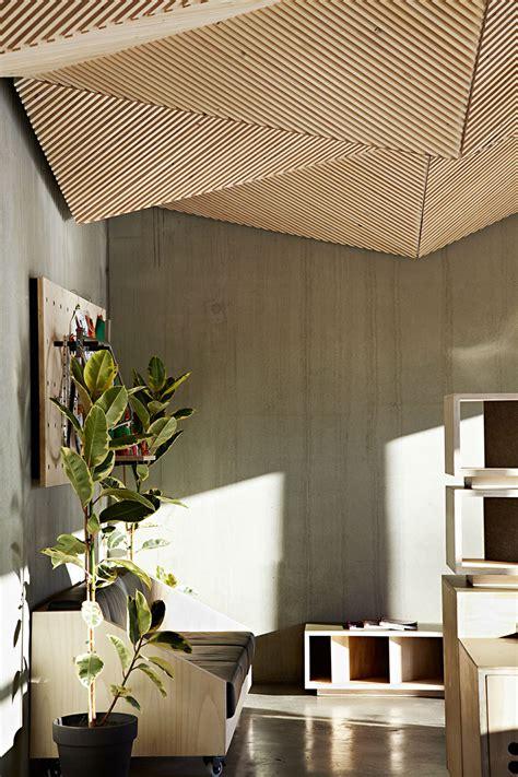 assemble studio features geometric origami ceiling