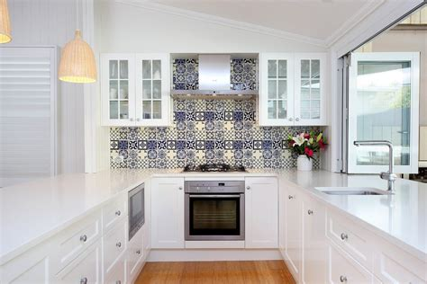 blue and white tile backsplash cobalt blue backsplash kitchen contemporary with bold color black granite countertop white cabinets
