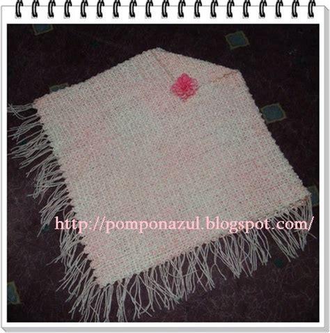 Hilo Di Pasaran entre mates y lazadas poncho tejido en telar manual