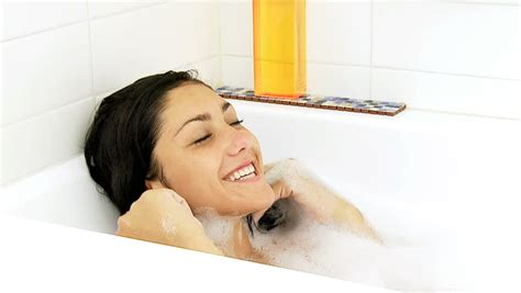 underwater bathtub girl beautiful woman singing in the shower while putting