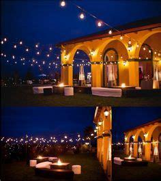 italian string lights backyard wedding with italian string lights hung overhead