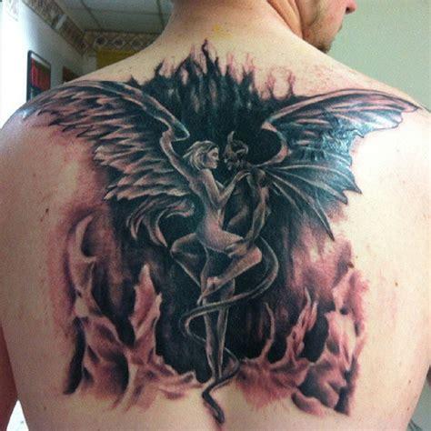 tattoo love angel angel demon love tattoo on upper back tattooshunt com