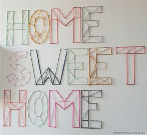 diy wall art from yarn nails diy word art ideas youramazingplaces com