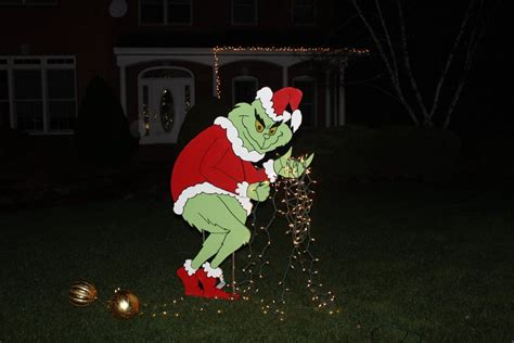 grinch pulling down lights grinch stealing lights yard grinch yard