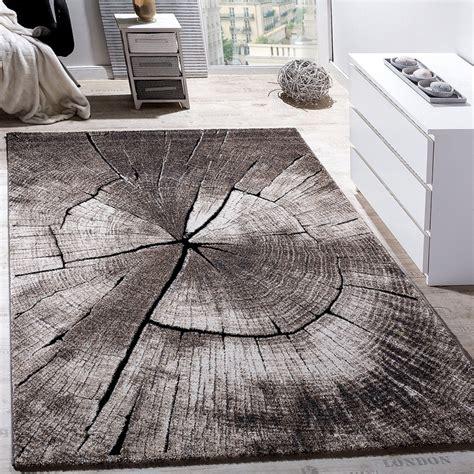 teppich grau braun edler designer teppich wohnzimmer holzstamm baum optik