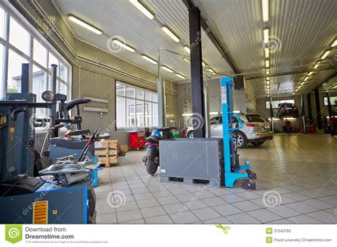 Agung Motor Service Station cars and equipment in workshop of service station