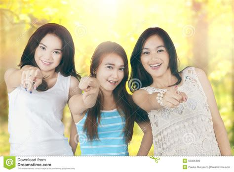 group teen girls laughing girls pointing at the camera in the nature stock photo