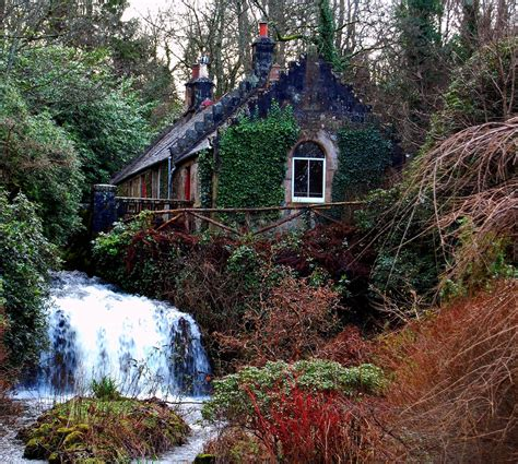 scottish woodland cottage and waterfall