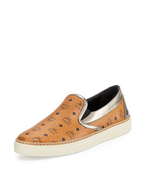 on sneakers mcm visetos monogrammed slip on sneakers in orange for