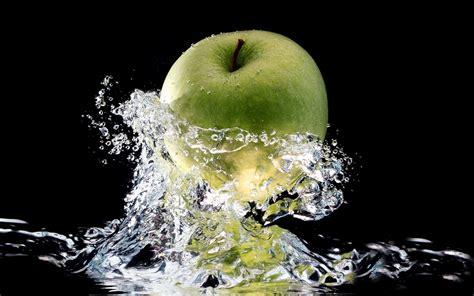 wallpaper apple water green apple in a splash of fresh water wallpaper 1288440