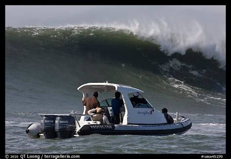 small boat in big waves picture photo small boat dwarfed by huge wave half moon