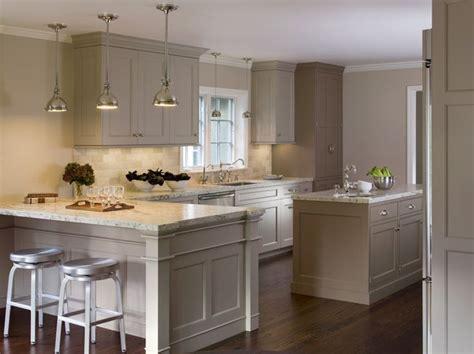 greige kitchen cabinets greige cabinets yoke pendants aluminum stools