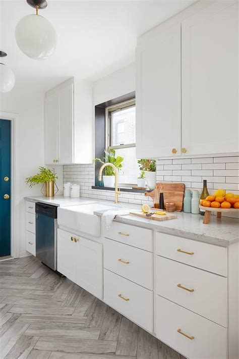 white and gold kitchen features white cabinets adorned white and gold kitchen with black windowsill transitional kitchen