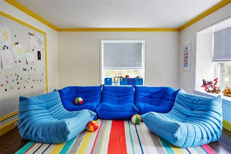 Wall Tiles Designs playroom with ligne roset togo fireside chairs