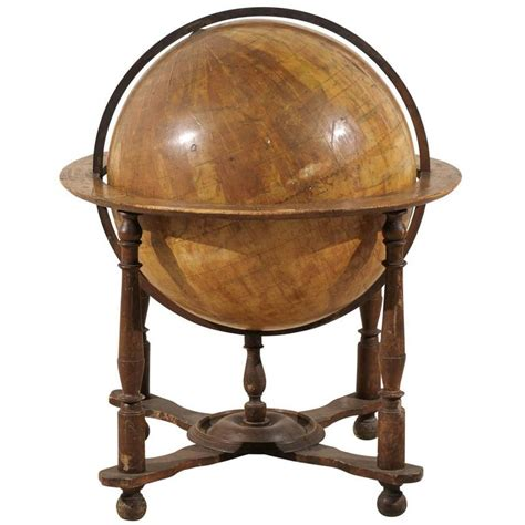 an italian 19th century heavily foxed globe on wood stand