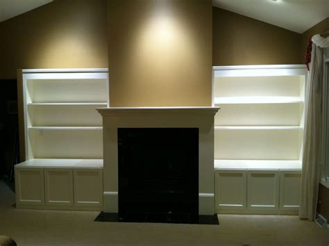 made build in media cabinets shelving fireplace