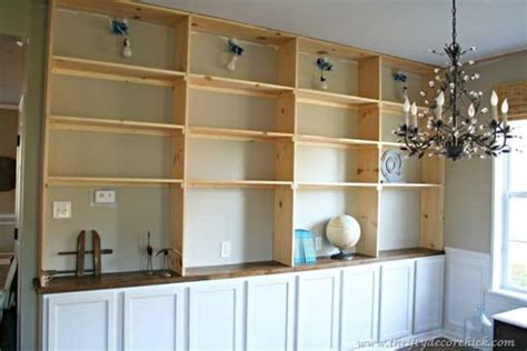 diy built ins with stock cabinets up your shelfie with these diy bookshelf ideas