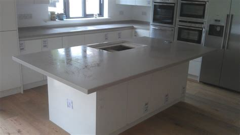 corian clay island on white mereway handless kitchen