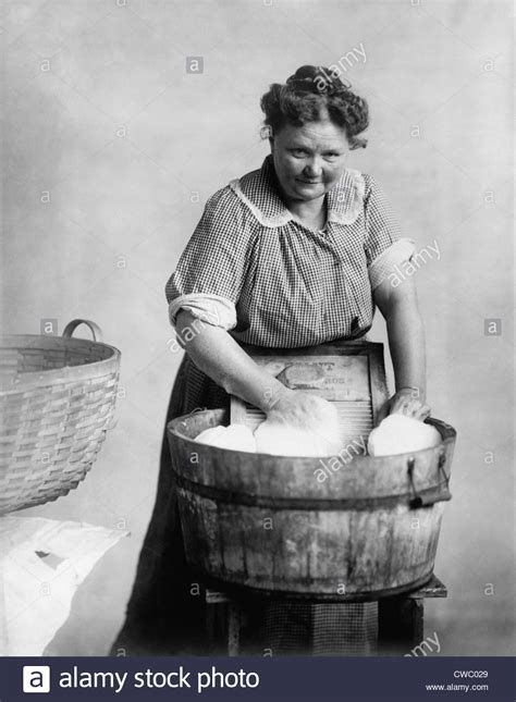how to do laundry in the bathtub woman doing laundry in wooden tub and metal washboard ca 1905 stock photo royalty