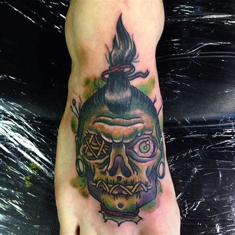 tattoo sewn lips awful shrunken head tattoo on forearm for men