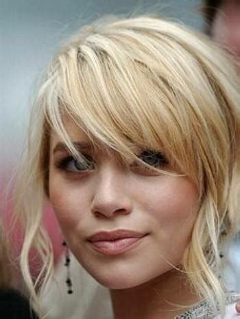 easiest bangs to maintain thick layered hair with sideswept bangs easy to