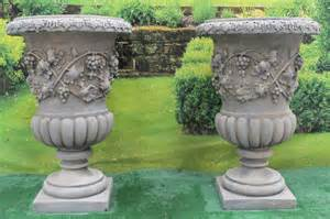 two beautiful antique style vine urns garden
