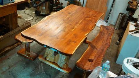 hand   edge cedar dining table  benches