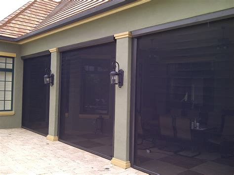 Interior Solar Screens by Motorized Hurricane Security Protection Shutters