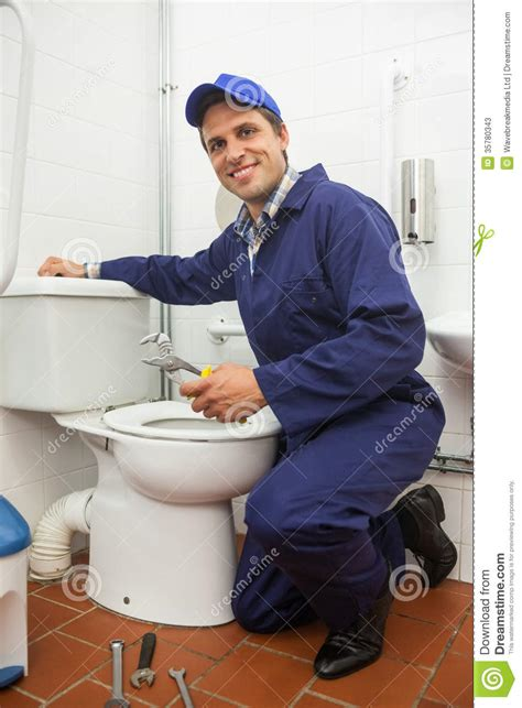 Plumbers Nearby Looking Plumber Repairing Toilet Stock Photos Image