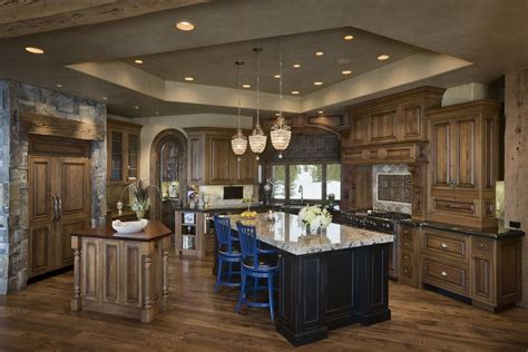 rustic kitchen with pendant light by locati architects