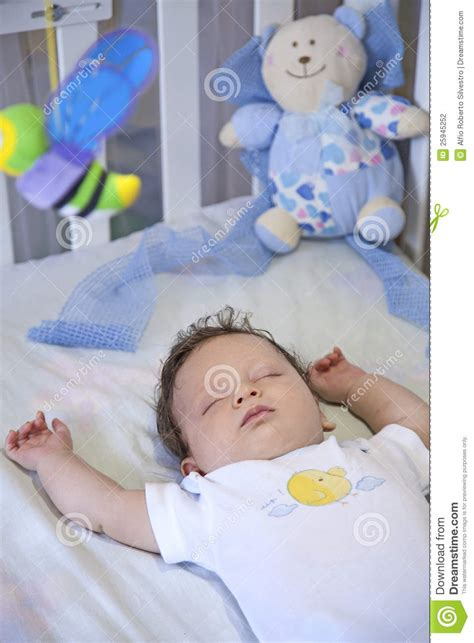 Pictures Of Babies Sleeping In Cribs by Baby Sleeping Peacefully In Crib Stock Photography