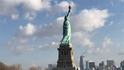 york city statue gif find  gifer
