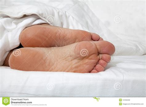 bed feet feet in bed royalty free stock images image 14169459