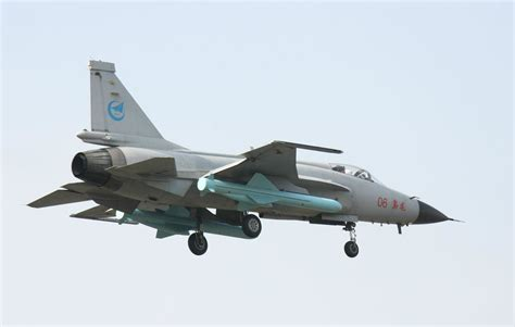 jf 17 thunder carrying two yj83 anti ship cruise missiles