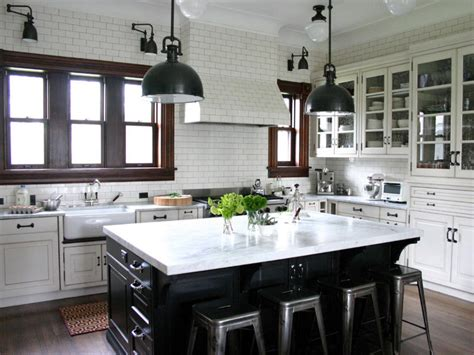 white kitchen with black island traditional kitchen in white subway tile with black island