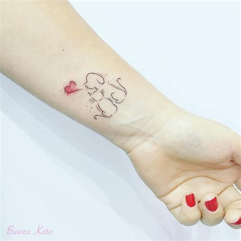 dog and cat tattoo 77 deliciously delicate wrist tattoos tattoomagz