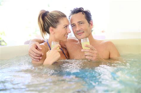 couples in bathtubs romantic couple spending good time drinking chagne in