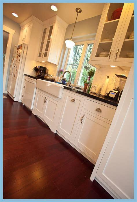 kitchen black counters white cabinets farm sink school