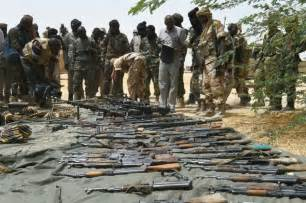 boko haram militants display control of captured towns in lake chad clashes leave 14 boko haram members dead