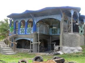 house builder building belize s first earthship alongside the mayan