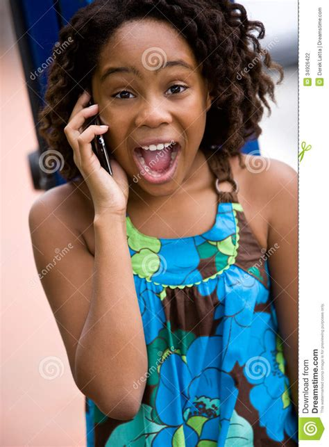 excited young lady  cellphone stock photo image