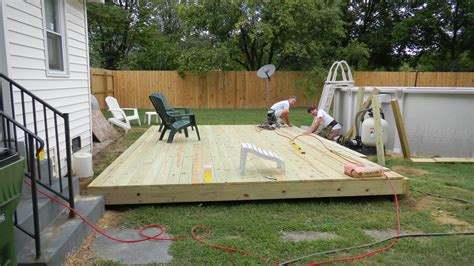 how to level backyard for pool ground level small rectangular deck ground level deck