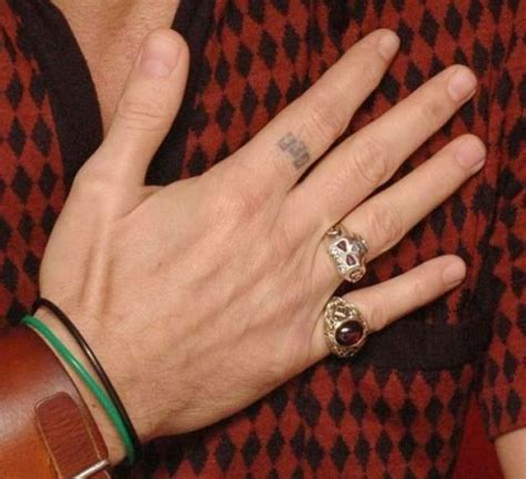johnny depp tattoo on ring finger diamond ring on right hand meaning simple second hand