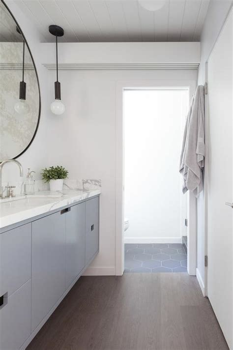 long thin bathroom gray floating vanity with oversized convex mirror
