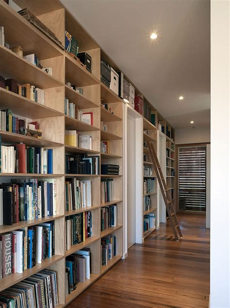 home library shelves posh urban residence down under enthralls with scenic bay